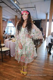 """Mimi Faust is a """"flower child"""" in this gorgeous sheer dress with floral detailing from H&M. I love that she accessorized her ensemble with a flower crown and tassel detailed heels."""